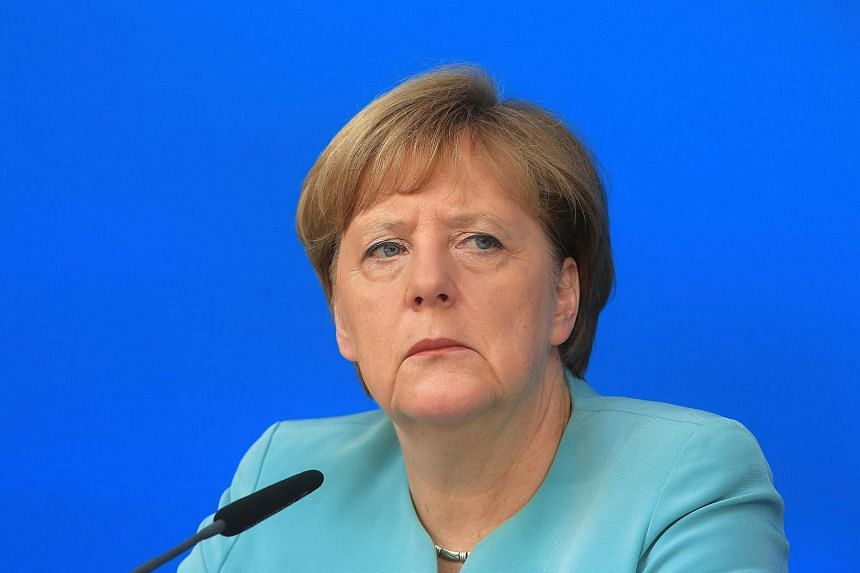 Angela Merkel, Germany's chancellor and leader of the Christian Democratic Union party, listens during a news conference in Potsdam, Germany, on June 25.