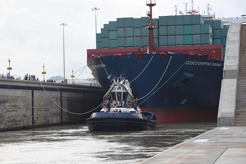 Chinese-chartered merchant ship Cosco Shipping Panama crosses the new Cocoli Locks during the inauguration of the Panama Canal expansion in Panama City.