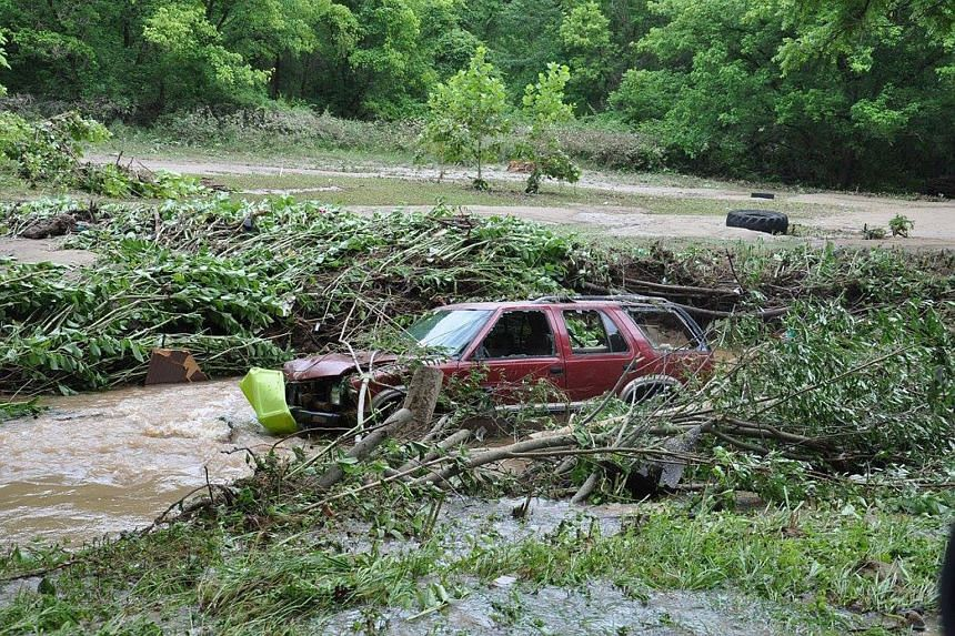 Flood damage near Elkview, West Virginia on June 24. Days of heavy rain caused massive flooding in the state, where high waters have washed away cars, trapped hundreds and cut power to large areas.