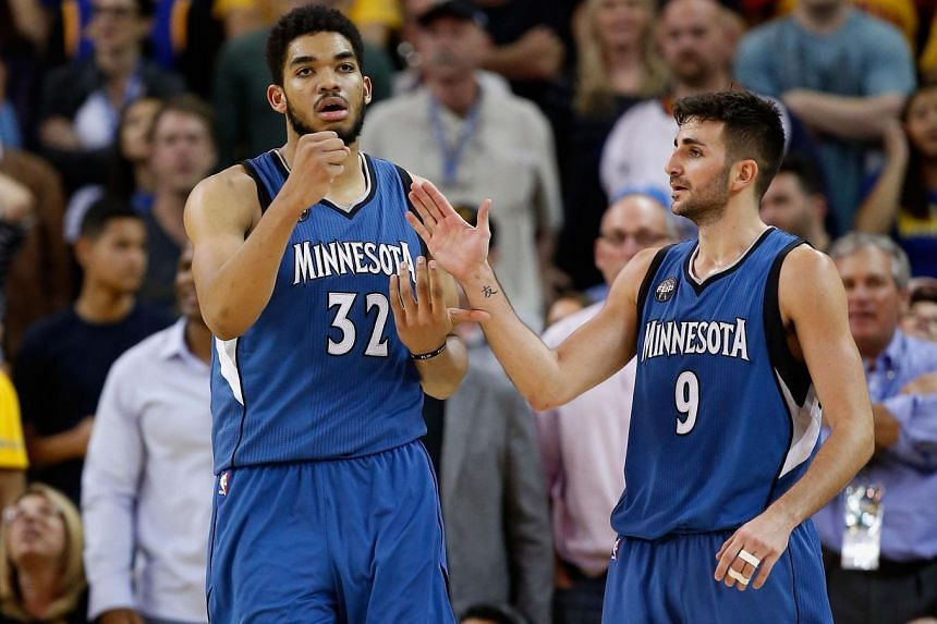 Karl-Anthony Towns (left) of the Minnesota Timberwolves is congratulated by Ricky Rubio after he made a basket against the Golden State Warriors on April 5, 2016.