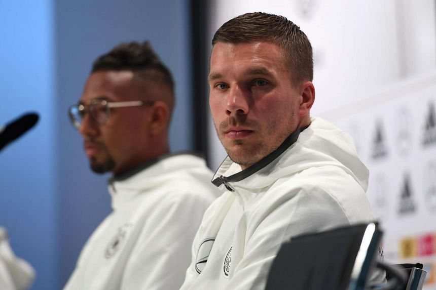 Germany's midfielder Lukas Podolski (right) at a press conference in Evian on June 14, 2016, during the Euro 2016 football tournament.