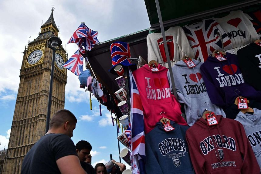 Tourists looking at London and Britian-themed merchandise in front of Big Ben, on June 26, 2016.