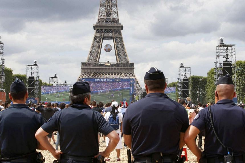French gendarmes maintain security near the Eiffel Tower in Paris, on June 26, 2016.