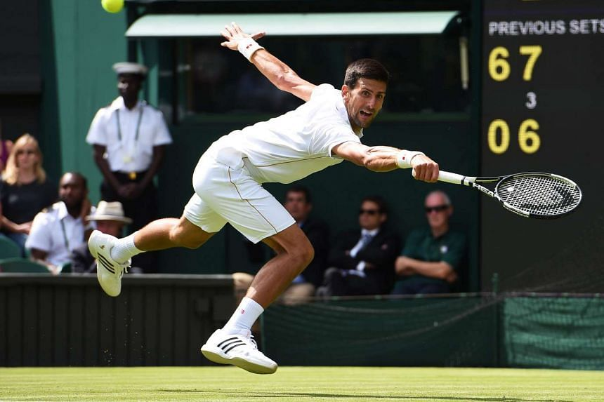 Novak Djokovic of Serbia returns to Britain's James Ward in their first round match of the Wimbledon Championships at the All England Lawn Tennis Club, in London, Britain, on June 27, 2016.