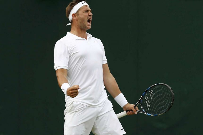 Great Britain's Marcus Willis celebrates after winning his match against Lithuania's Ricardas Berankis.