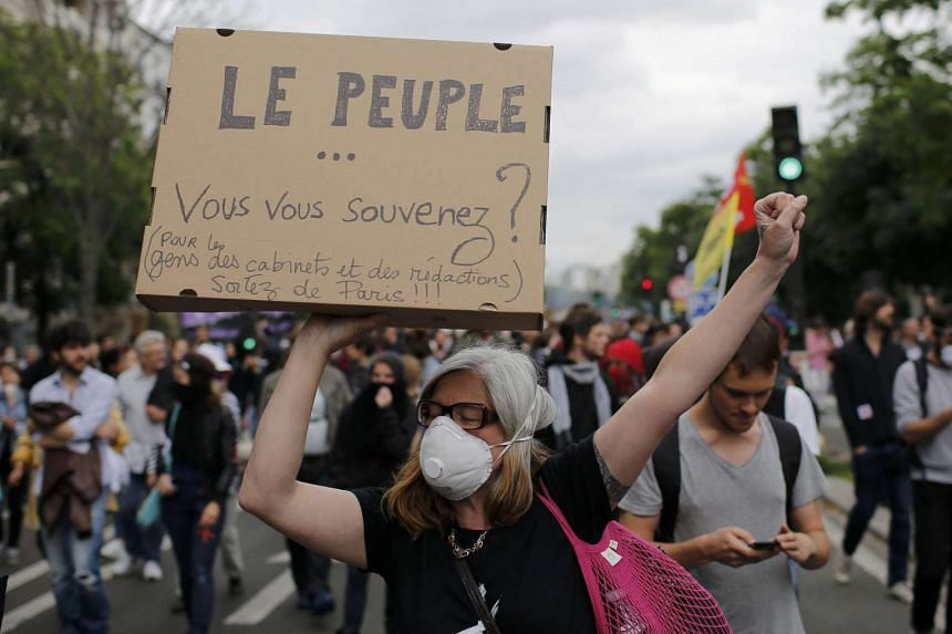 French protesters march during a demonstration against plans to reform labour laws, in Paris on June 28, 2016.
