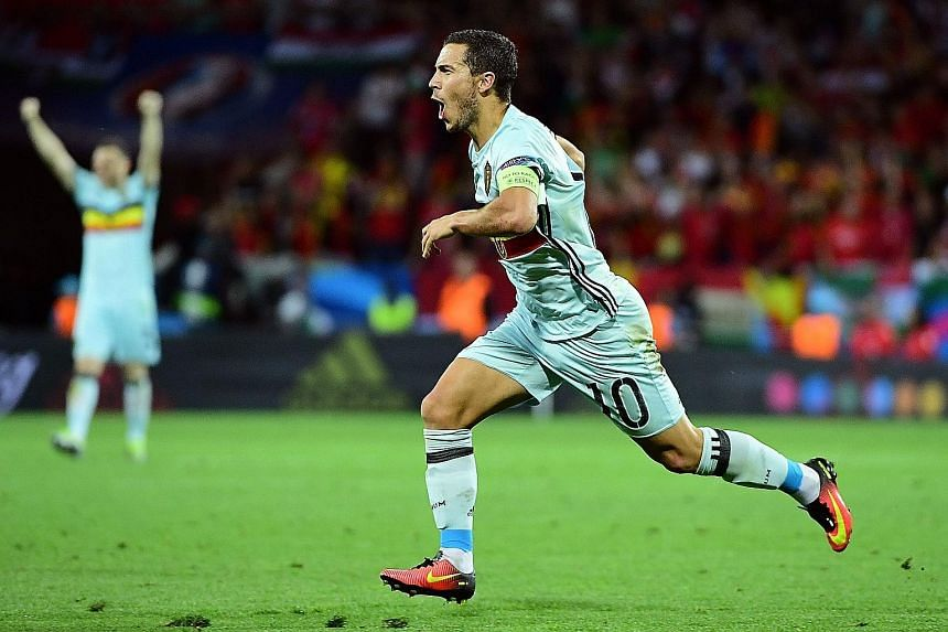 Belgium's Eden Hazard celebrating after scoring the third goal in his team's 4-0 win against Hungary in Toulouse on Sunday.