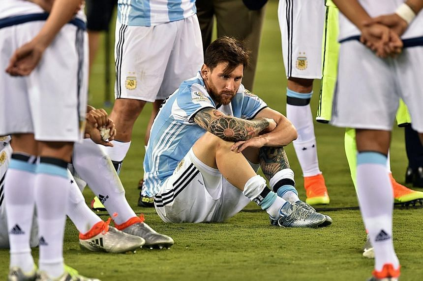 Messi waiting to receive the second-place medal following Argentina's shock loss to Chile in the Copa America final in New Jersey in the United States on Sunday. The soccer sensation announced his retirement from international football after failing
