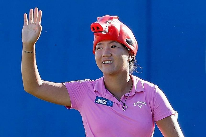 Lydia Ko of New Zealand wearing an Arkansas Razorbacks hat in the shape of its trademark hog. The 19-year-old has now recorded her third victory of the year.