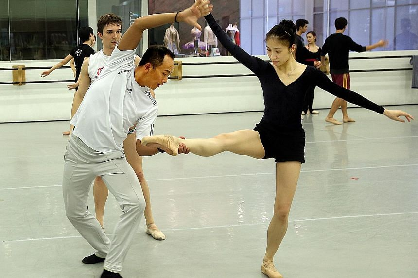 Ma Cong (left), choreographer of two pieces for Ballet Under The Stars, in a rehearsal.
