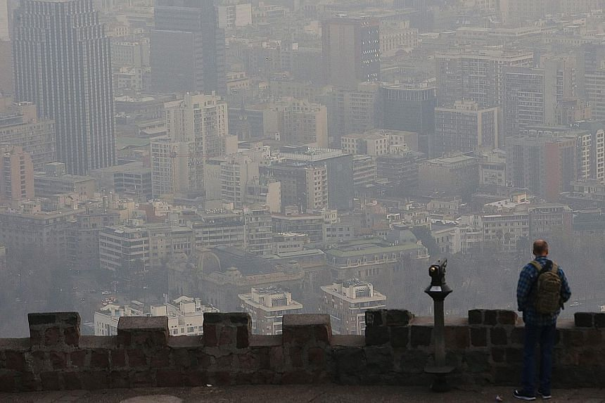 Smog blanketing buildings in the Chilean capital Santiago this month. The IEA says that without action, premature deaths attributable to outdoor air pollution will increase to 4.5 million in 2040, from about three million now. Asia will account for a