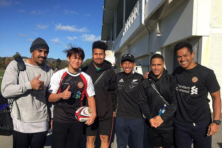Marcus Ng (second from left) and Muhammad Nur Solihin Mansor (third from right) had a chance to meet All Blacks (from left) Jerome Kaino, Mardie Savea, and Aaron Smith during their training stint in Wellington. At right is SRU senior rugby developmen