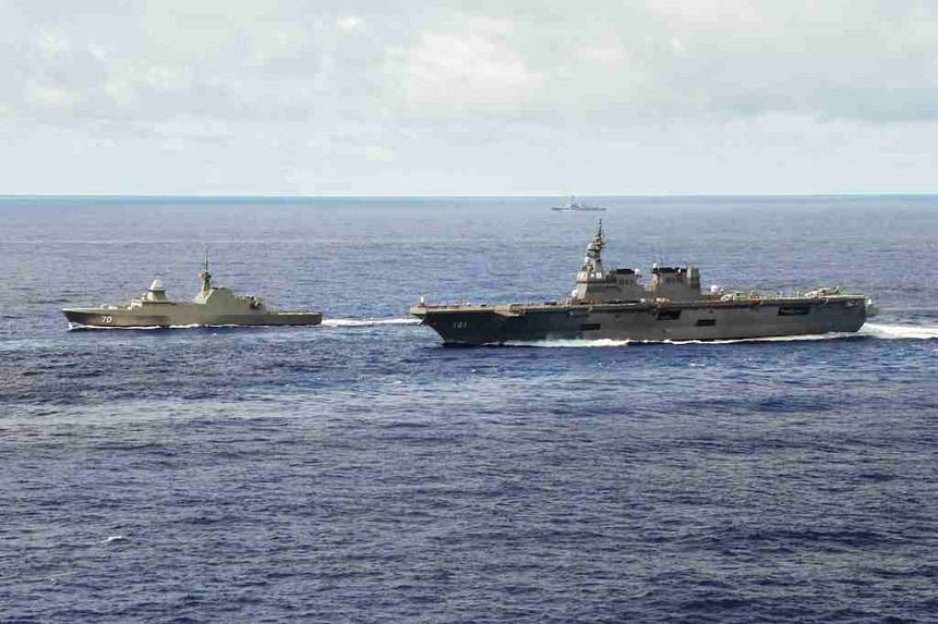 The RSS Steadfast (left) leading the multi-national group sail with two other warships from the Japan Maritime Self-Defense Force (right) and US Navy (in far background).