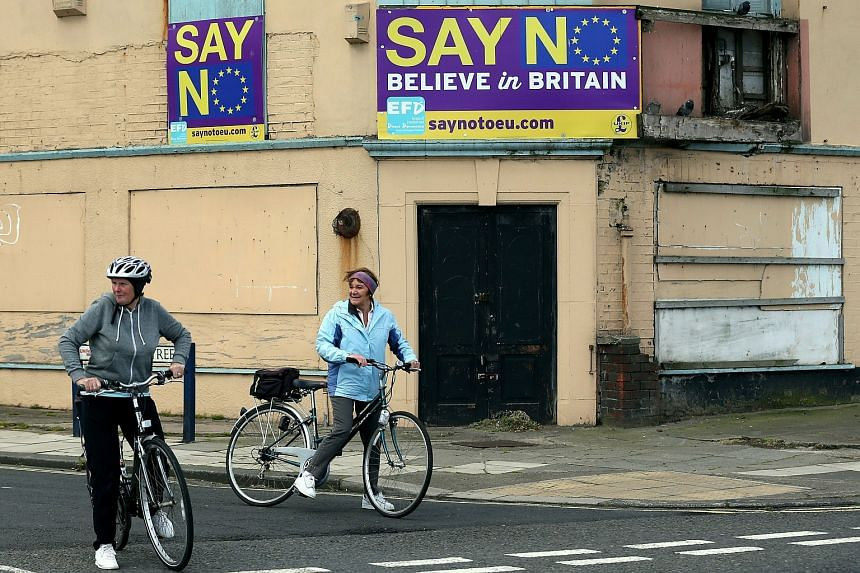"""""""Say No Believe in Britain"""" boards are displayed on a building in Redcar, north-east England."""