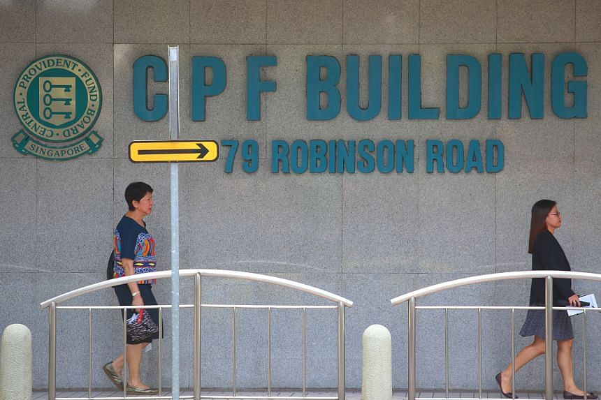Pedestrians outside the CPF Building at 79 Robinson Road.