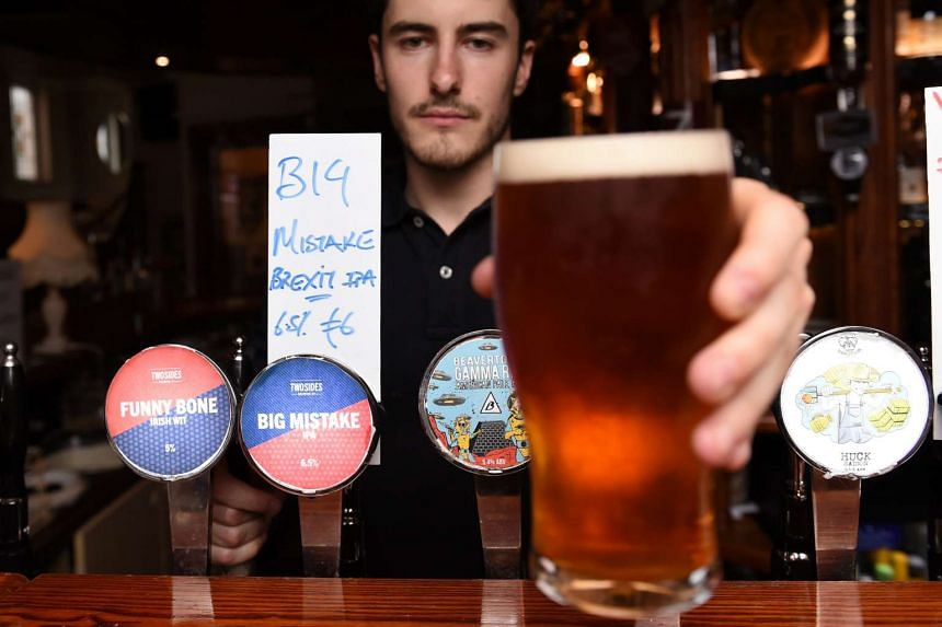"""A bartender serving a specially crafted Brexit beer called """"Big Mistake"""", in a bar in Dublin, on June 26, 2016."""