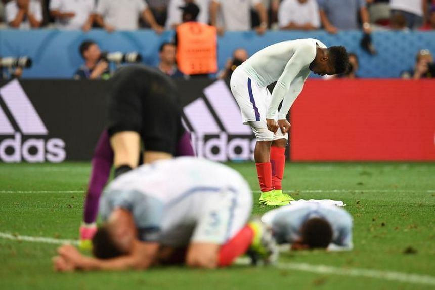 England's Daniel Sturridge (back) and England's defender Gary Cahill reacts after losing 1-2 to Iceland in the Euro 2016 round of 16 football match.