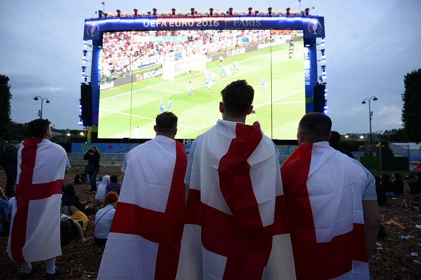 England's fans watch the football match between Iceland and England at the Champ-de-Mars fan zone in Paris.