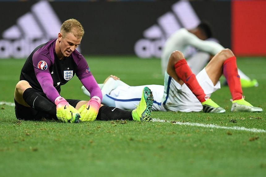 England's goalkeeper Joe Hart (left) reacts after losing 1-2 to Iceland in the Euro 2016 round of 16 football match between England and Iceland.