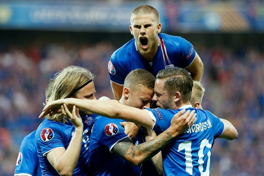 Iceland's Ragnar Sigurdsson celebrates scoring their first goal against England.