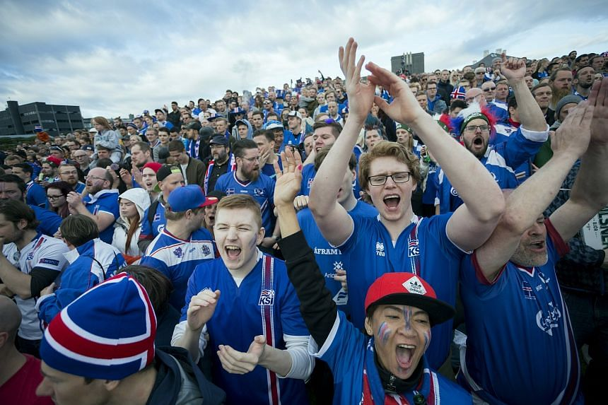 Iceland supporters celebrate during a public viewing of the Euro 2016 match between England and Iceland in Reykjavik.