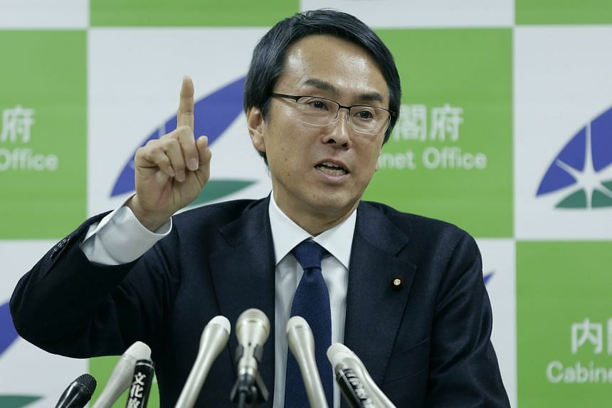 Nobuteru Ishihara, Japan's new economy minister, gestures as he speaks during a news conference in Tokyo.