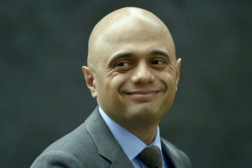 Britain's Business Secretary, Sajid Javid, leaves after a cabinet meeting in Downing Street in central London.