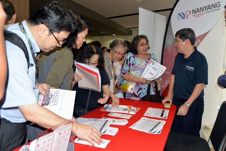 Seniors at a booth at the National Silver Academy Showcase a Temasek Polytechnic on June 28, 2016.