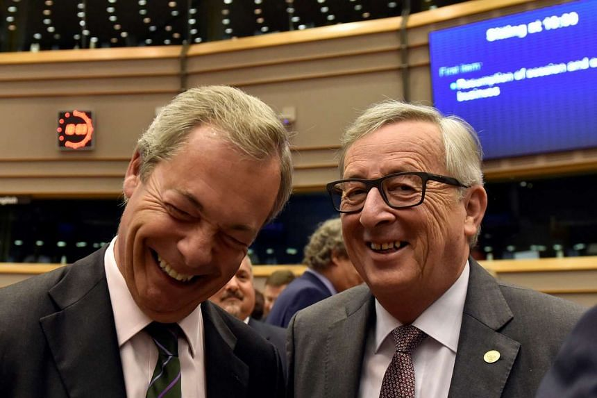 "European Commission president Jean-Claude Juncker welcomes Nigel Farage, prior to a plenary session at the European Parliament on the outcome of the ""Brexit"" in Brussels, on June 28, 2016."