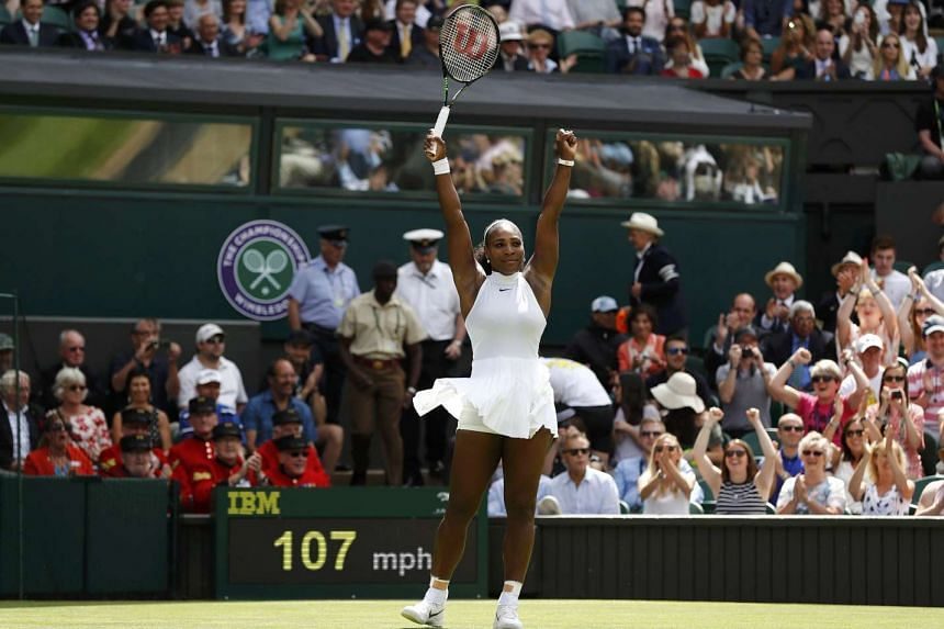 Serena Williams celebrates winning her match against Switzerland's Amra Sadikovic at the 2016 Wimbledon Championships on June 28, 2016.
