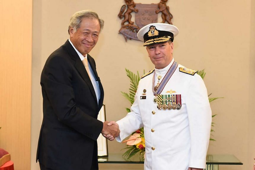 Minister for Defence Ng Eng Hen shaking hands with Chief of the Royal Australian Navy Rear Admiral Timothy Barrett after the investiture.