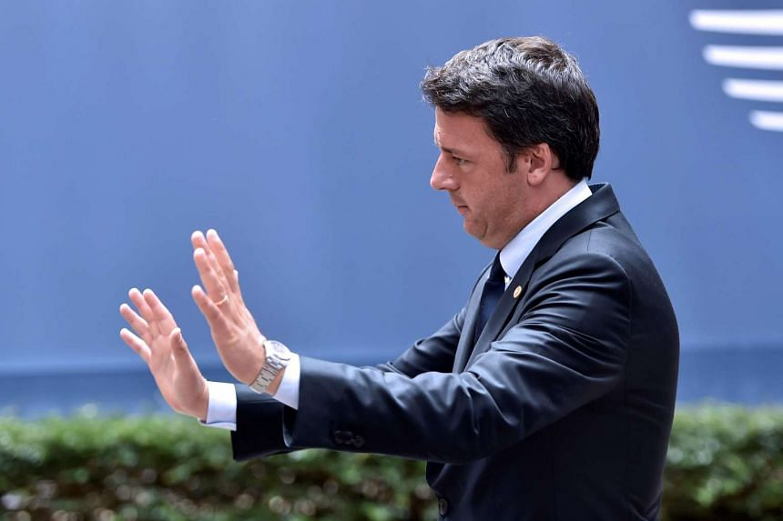 Matteo Renzi gestures as he arrives before an EU summit meeting on June 28, 2016, at the EU headquarters in Brussels.