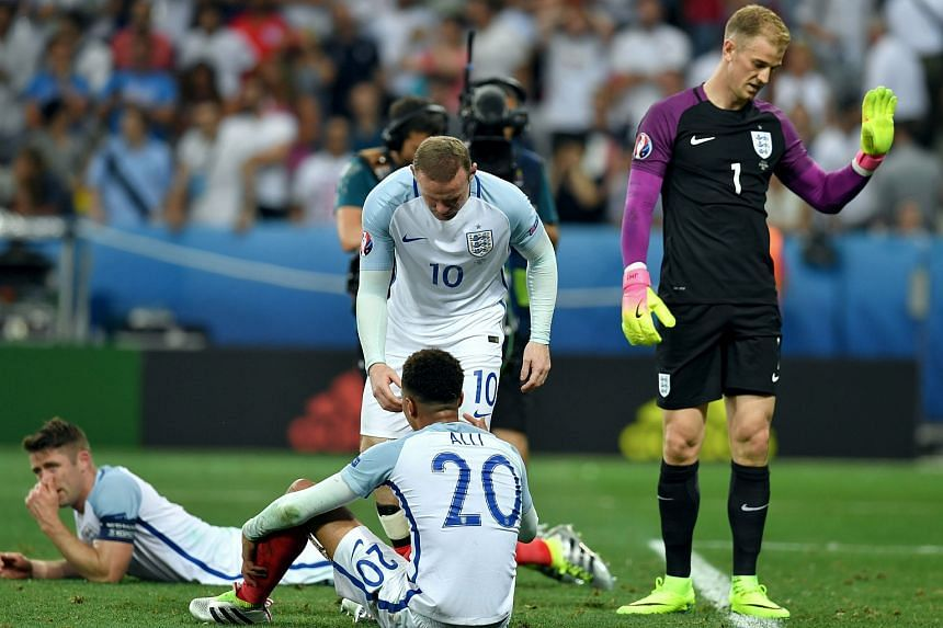 England's (left to right) Gary Cahill, Wayne Rooney, Dele Alli and goalkeeper Joe Hart react after losing their Uefa Euro 2016 round of 16 match against Iceland.
