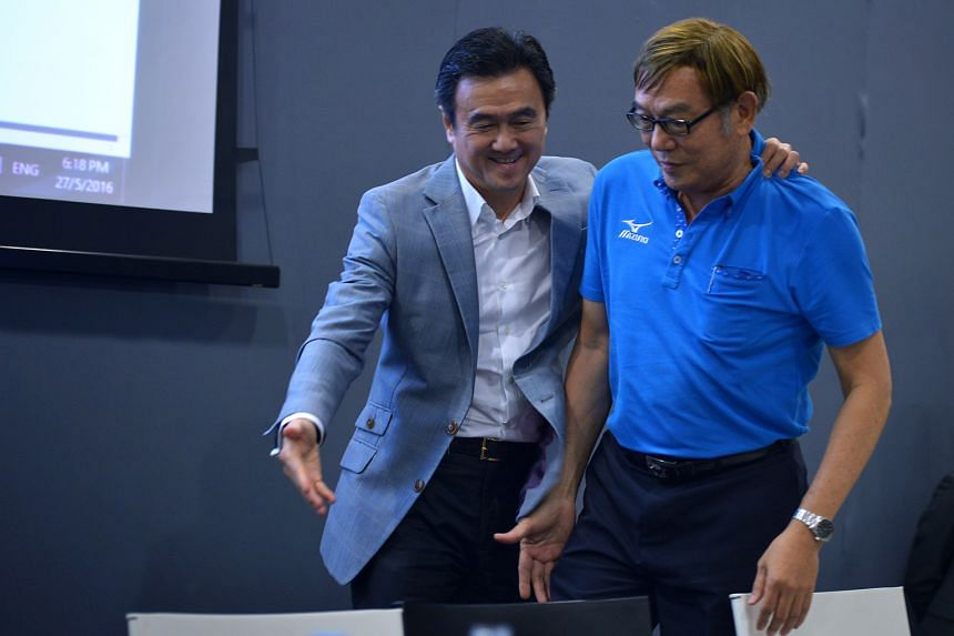 Former Singapore Athletics president Tang Weng Fei (left) congratulating his successor Ho Mun Cheong after the latter beat lawyer Edmond Pereira 11-9 following a second round of voting at the AGM last night. Ho's team won 12 of the 14 posts contest