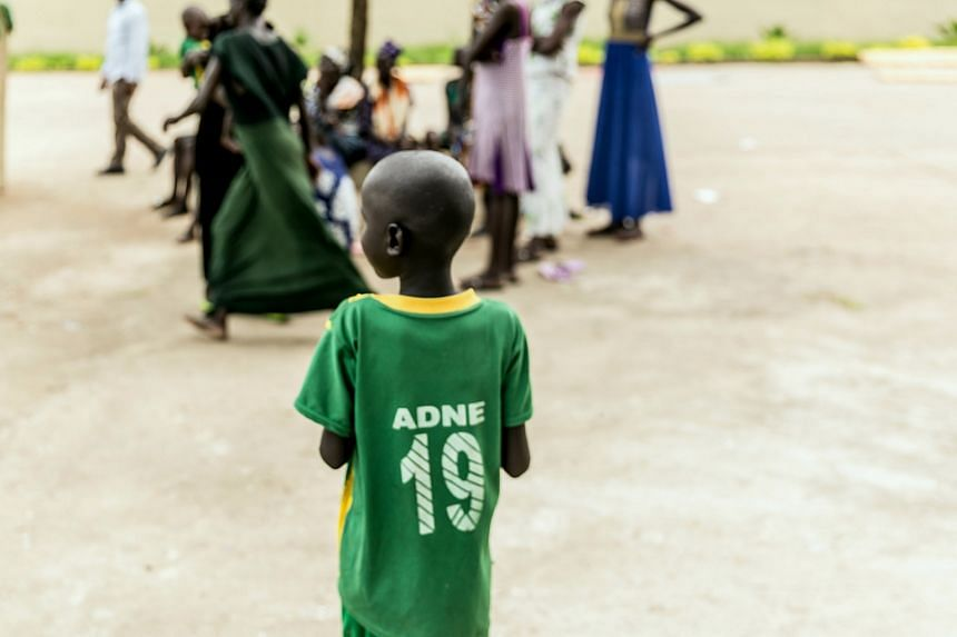An Ethiopian child observing a group of people in Gambella.