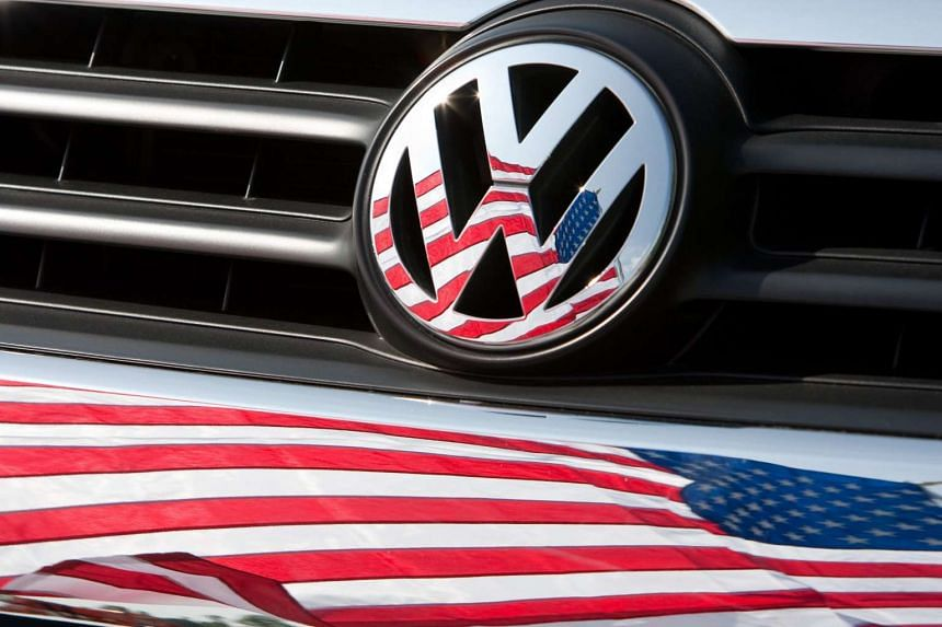 A US flag reflected in the hood of a Volkswagen car in Chattanooga, Tennessee.