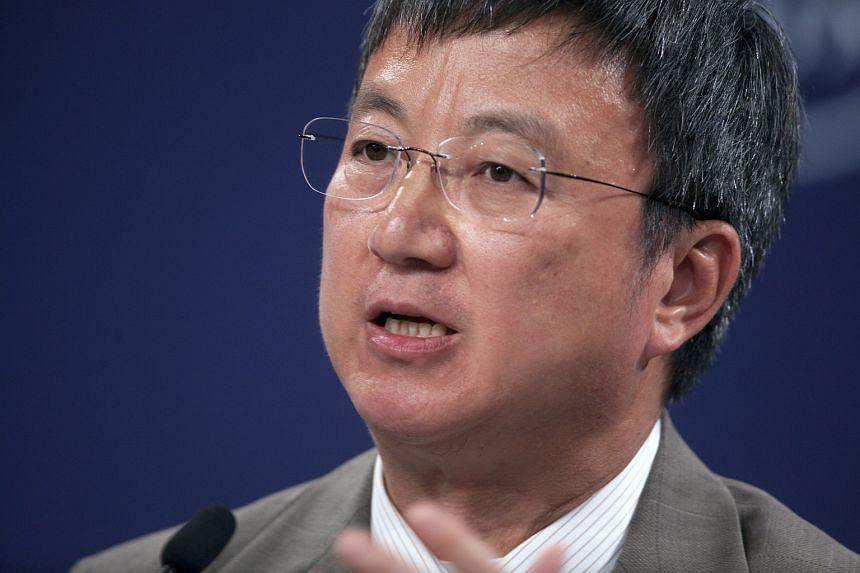Zhu Min, deputy managing director of the International Monetary Fund, speaks during a panel discussion at the World Economic Forum Annual Meeting of the New Champions in Dalian.