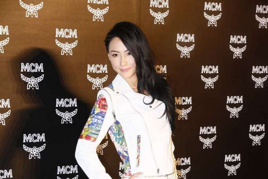 An Indonesian maid has been charged with stealing valuables worth about HK$460,000 (S$80,000) from actress Cecilia Cheung's (above) apartment.