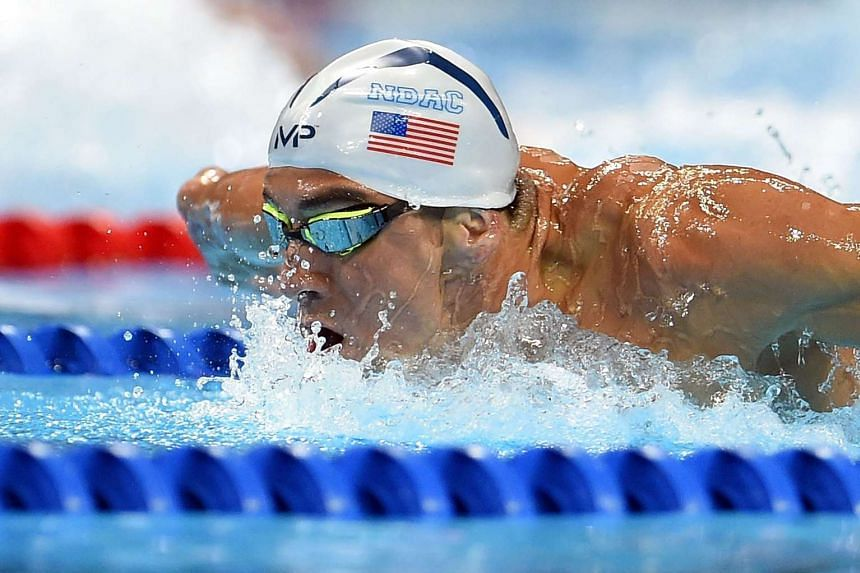 Michael Phelps competes in a preliminary heat of the men's 200m butterfly.