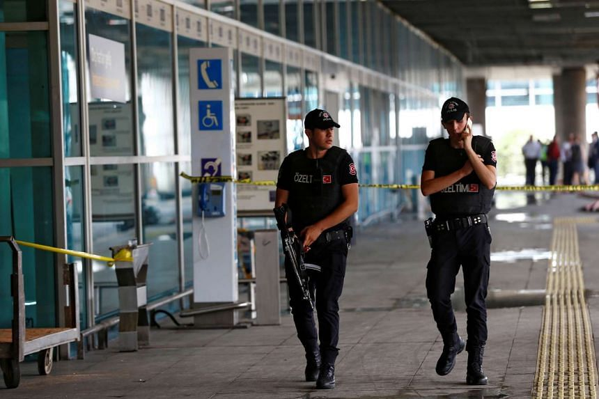 Police officers patrol at Turkey's largest airport, Istanbul Ataturk, on June 29, 2016.
