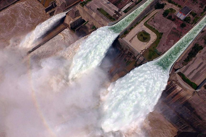 Water is released from the floodgates of the Xiaolangdi dam on the Yellow River near Luoyang, in China's Henan province on June 29, 2016.