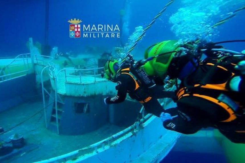A handout photo showing the migrant ship which sank off Sicily in 2015 being recovered by the Italian Navy on June 28, 2016.