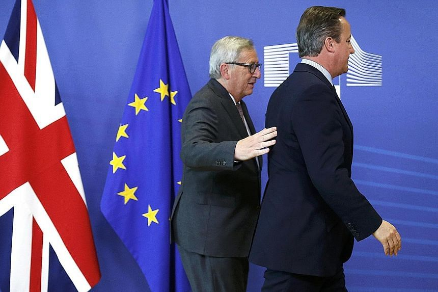 Hello and goodbye. British PM David Cameron (right) and EU Commission president Jean-Claude Juncker arriving at the EU Summit in Brussels yesterday. The summit comes amid anger among European leaders over Mr Cameron's decision to call the Brexit refe