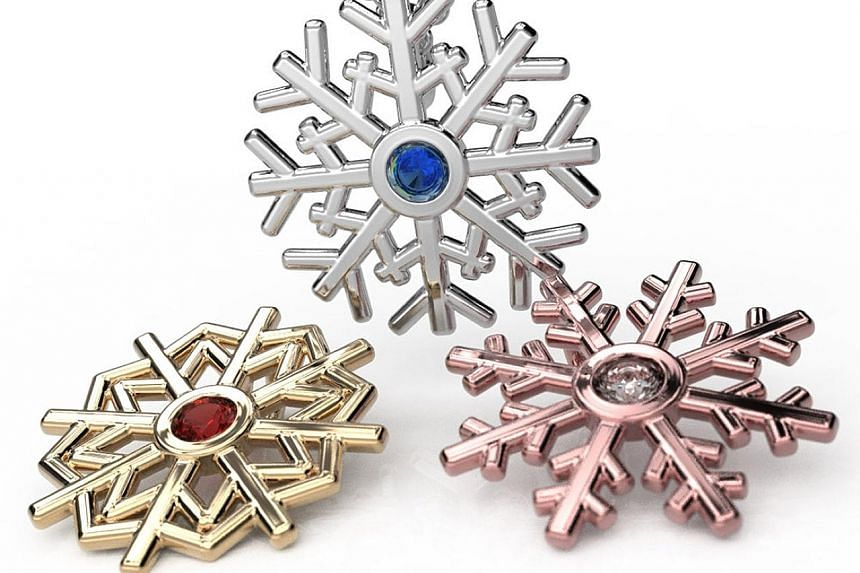 Polychemy's pendants with a dazzling snowflake design. Like snowflakes, each pattern is unique, says the company's founder, Mr Isaac.