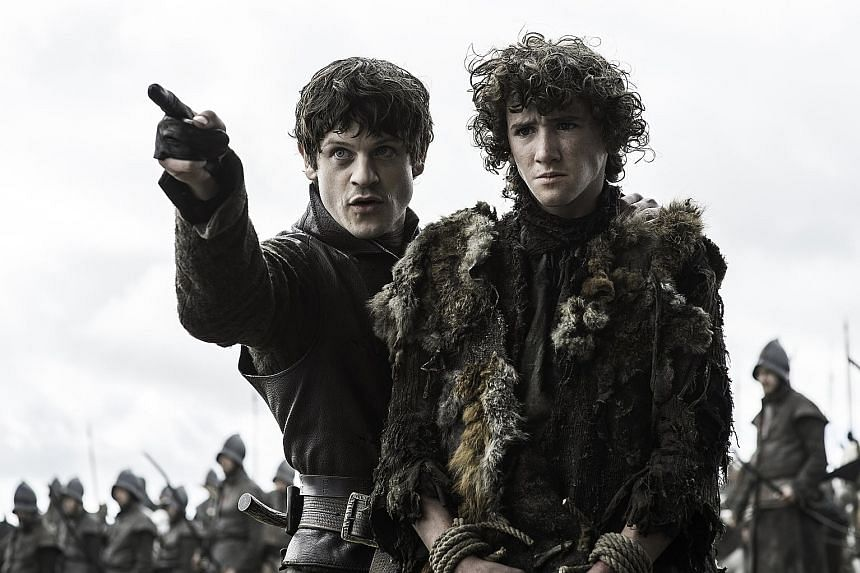Ramsay Bolton (Iwan Rheon, above left) and Rickon Stark (Art Parkinson) in a scene from Season 6 of Game Of Thrones.