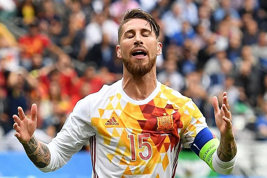 Spain's fall from grace is marked by the anguish of Sergio Ramos, a member of the last two triumphant Spanish Euro teams. Graziano Pelle volleying past Spain goalkeeper David de Gea to seal Italy's 2-0 win, turning the tide between the two sides. The