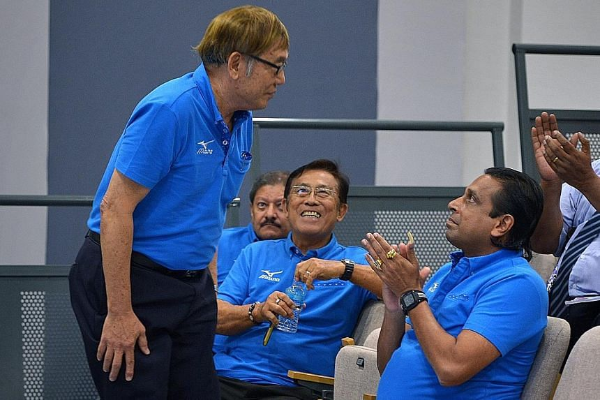 Singapore Athletics president Ho Mun Cheong (standing) and his committee members Govindasamy Balasekaran and Loh Chan Pew have acknowledged the challenge ahead to deliver more success.
