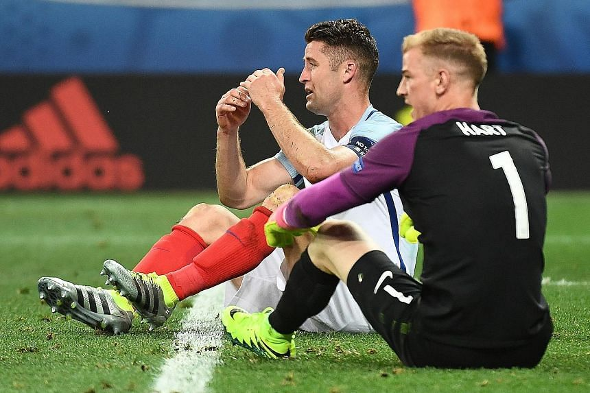 Gary Cahill and Joe Hart are completely floored after England's capitulation in the round of 16. Both had failed to cover themselves in glory against Iceland, as a slew of defensive errors contributed to their exit.