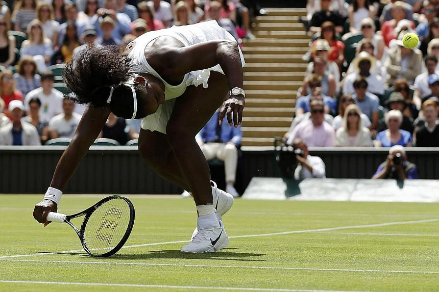 Serena Williams returning against Switzerland's Amra Sadikovic. The American endured a poor service game with five double faults and only four aces to win in straight sets and progress to the second round at the All England Club.