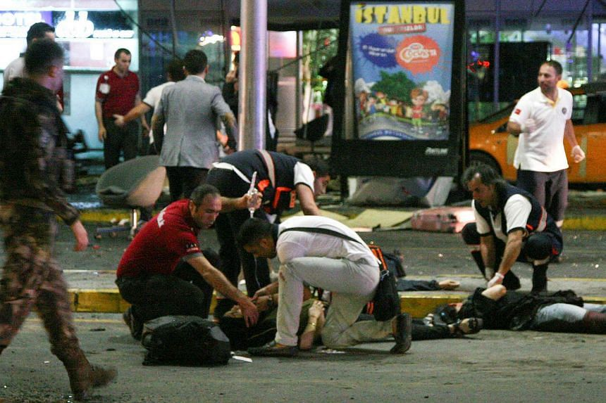 Paramedics attend to casualties injured outside Istanbul Ataturk airport, Turkey on June 28.